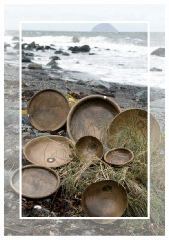 wooden bowls by the shore