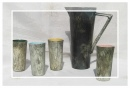 Ceramic pitcher and beakers