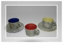 Teacups and saucers in various colours